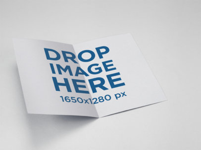 Bifold Brochure Mockup Lying on a Solid Color Surface a15203