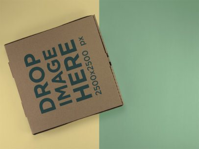 Top Shot Mockup of a Pizza Box Lying on a Two Colors Surface a15222