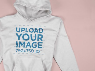 Closeup Mockup of a Pullover Hoodie Lying on a Solid Surface a15243