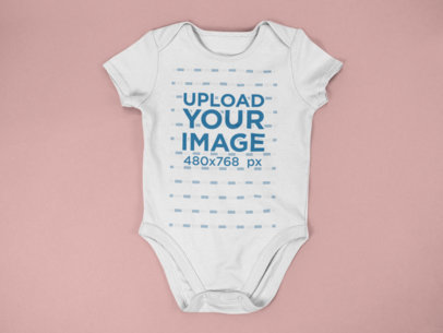 Baby Onesie Mockup Lying on a Flat Surface a15264