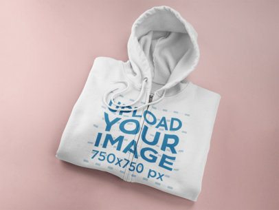 Mockup of a Folded Full Zip Hoodie Lying on a Flat Surface a15224