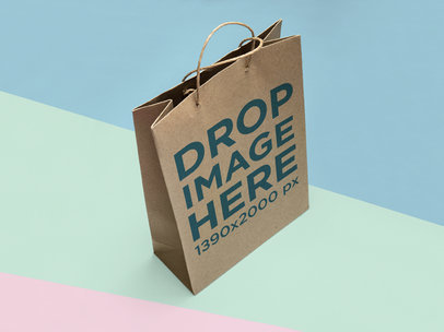 Top Shot Mockup of a Paper Bag Standing on a Tricolor Surface a15307