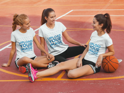 Three Girlfriends Having Fun Wearing Different Tshirts Mockup While Sitting in a Basketball Court a15491