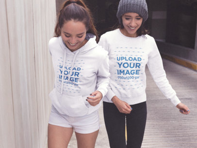 Mockup of Two Women Outside of a Tunnel Wearing a Pullover Hoodie and a Crewneck Sweatshirt a15479