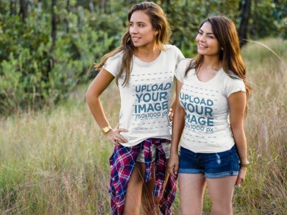 Pair of Girls Wearing Different Tshirts While Standing Outdoors a15498