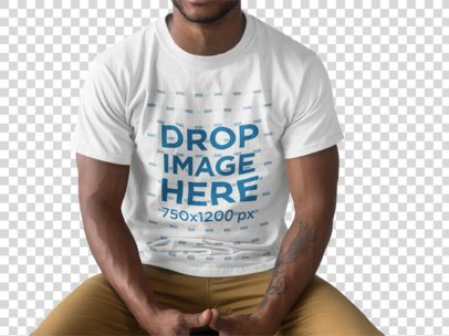 Young Black Man Wearing a Round Neck Tee Mockup While SItting Down With Cropped Face a15465