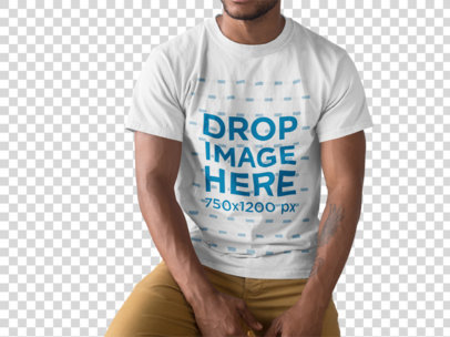 Young Black Man Wearing a Round Neck Tshirt While Sitting Against a Transparent Backdrop a15474