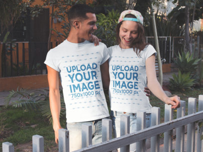 Couple Wearing Different Tees Mockup Walking Outdoors a15536