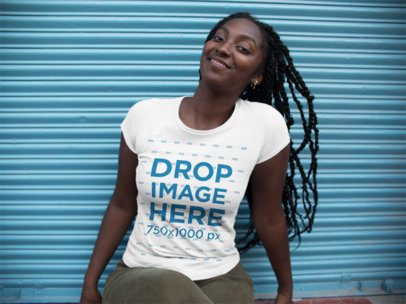 Mockup of a Beautiful Black Woman Wearing a Round Neck T-Shirt While Sitting Down a15543