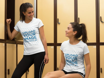 Two Girlfriends Talking in the Dressing Room and Wearing Different T-Shirts Mockup a15667