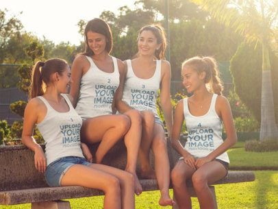 Group of Four Girls Having Fun Talking at a Park While Wearing Different Tank Tops Mockup a15688