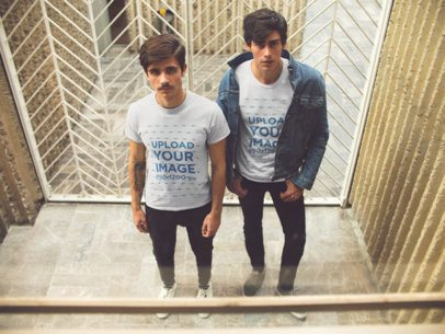 Two Guys Standing Outside a Vintage Elevator Wearing Different T-Shirts Mockup a15733