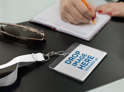 Mockup of a Badge Holder Lying Near a Girl While Writing a15148