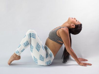 Girl in a Yoga Pose Wearing Leggings Mockup in a White Room a15390