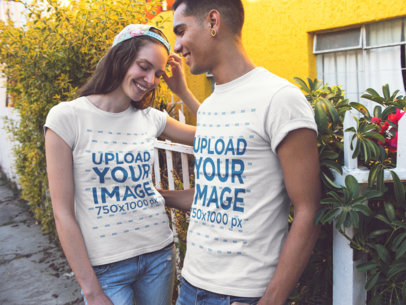 Smiling Couple in the Street Wearing Round Neck T-Shirts Mockup a15797