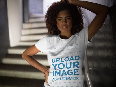 Mockup of a Woman Hiding on Stairways While Wearing a Round Neck T-Shirt 15834
