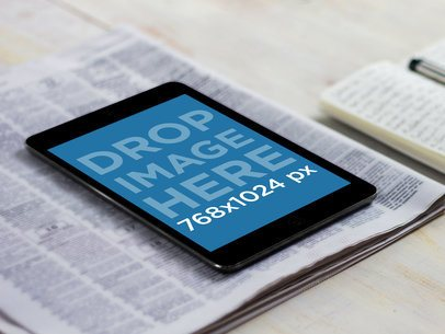 iPad Mini Over A Newspaper