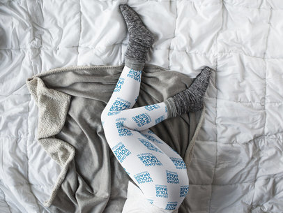 Mockup of Leggings Being Worn by a Girl with Gray Socks Lying on a Bed a15701