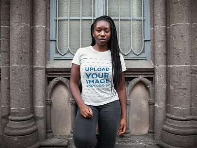 Mockup of a Woman with Braids Wearing a T-Shirt Mockup While Outside a Church a15953