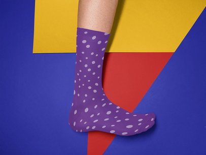 Mockup of a Mans Foot Wearing a Sock Against a Tricolor Surface a15612