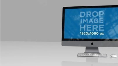 iMac Video Standing on a Flat Reflective Surface a15963