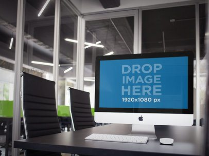 Mockup of an iMac at an Office Conference Room a5191