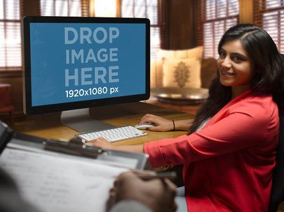 Mockup of a Young Businesswoman at the Office Using an iMac a5148