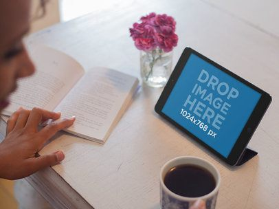 Tablet Mockup of a Lady Reading at a Cafe While Using Her iPad a5522