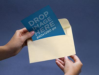 Envelope Mockup Featuring a Person Opening an Envelope a6554