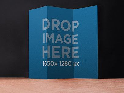 Brochure Mockup Standing Over a Wooden Surface a6215
