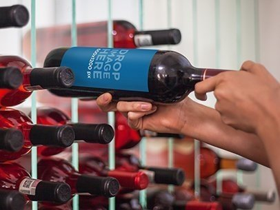 Label Mockup Featuring a Man Taking a Wine Bottle From a Wine Cellar a6706