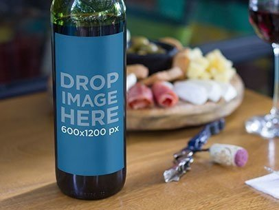Label Mockup of a Wine Bottle Standing on Top of a Table at a Restaurant a6948