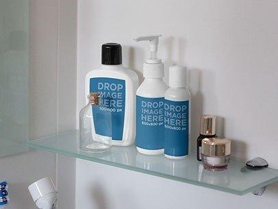 Label Mockup Featuring a Set of Bottles on a Bathroom Shelf a7265