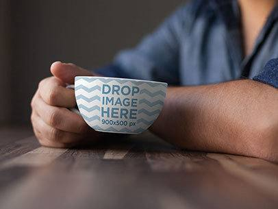 Coffee Cup Mockup of a Man at a Café Having a Coffee a7019