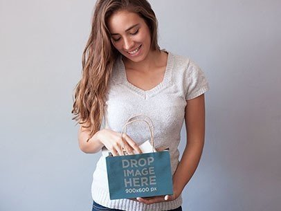 Packaging Mockup of a Young Woman Holding a Shopping Bag a6977