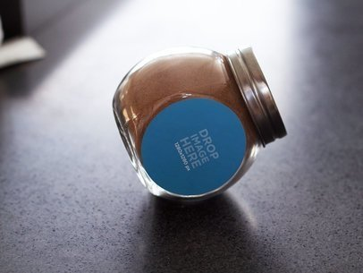 Packaging Mockup of a Glass Container on Top of a Kitchen Counter a7206