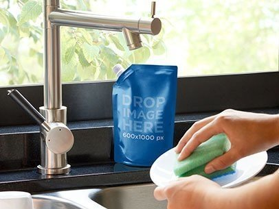 Packaging Mockup of a Liquid Soap Bag Next to a Kitchen Sink a7197