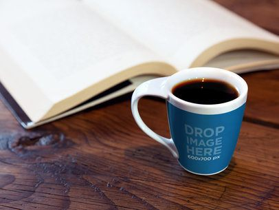 Cup Mockup of a Cup Standing Next to a Book on Top of a Desk 6952