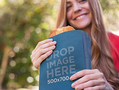 Paper Bag Mockup Featuring a Young Woman Eating a Sandwich a7254