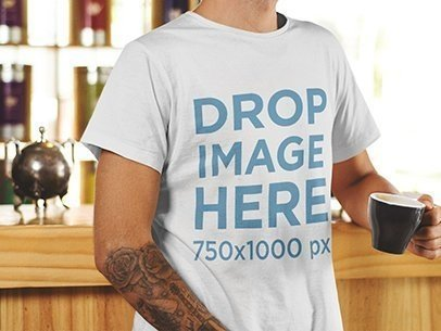 T-Shirt Mockup of a Young Man Holding a Cup of Coffee 1061a