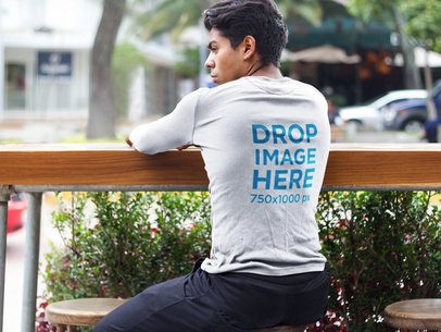 Young Man Sitting on a Stool Long Sleeve Tee Mockup a6092