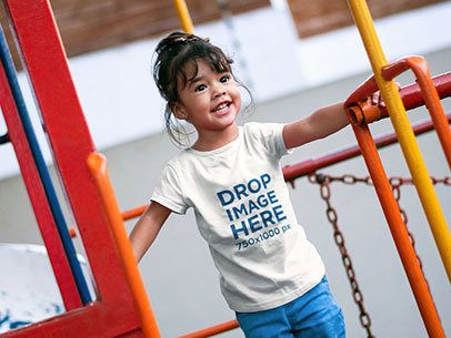 Little Girl Having Fun at a Playground T-Shirt Mockup a7703