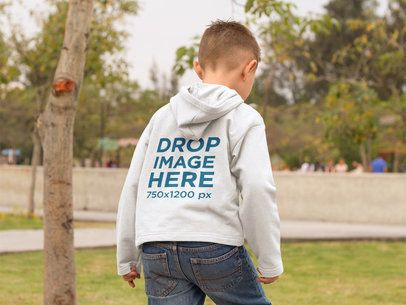 Mockup of a Little Kid Wearing a Hoodie while at the Park a9121b