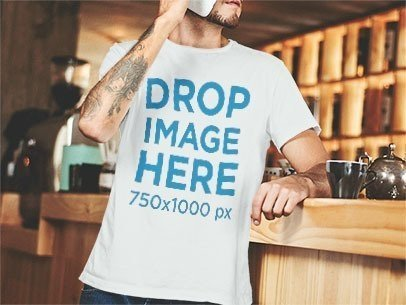 T-Shirt Mockup of a Man Leaning Against a Coffee Bar Counter a1060