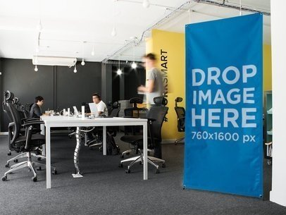 Vertical Banner Mockup in a Creative Office a10395