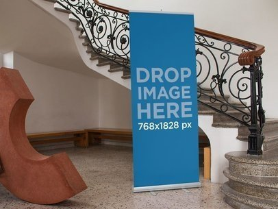 Vertical Banner Mockup Standing Next to a Staircase a10562