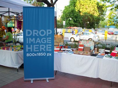 Vertical Banner Mockup in a Street Market a10662