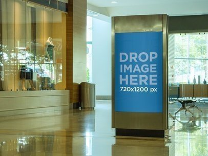 Billboard Mockup Outside a Clothing Store at a Mall a10611