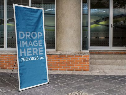 Vertical Banner Mockup in Front of a Glass Building a10387