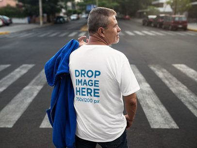 Back of a Middle Aged Man Wearing a Round Neck Tee Mockup while Crossing the Street a10814b